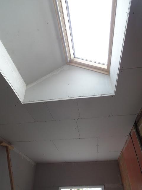 plasterboard around roof window in flat ceiling