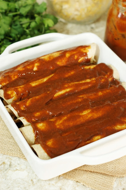 "Simple Chicken Enchiladas ~ Chicken & cheese filling seasoned simply for just the right flavor ""oomph"" & moistness.  Make a pan for tonight, and one to freeze for later!   www.thekitchenismyplayground.com"