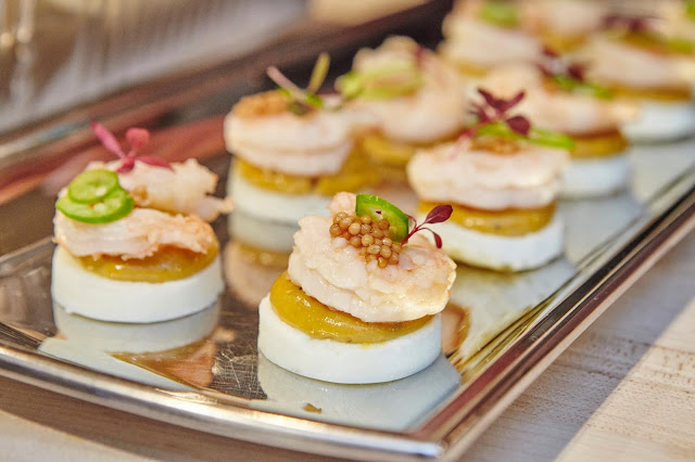 Jay D's Lousiana Molasses Mustard Deviled Eggs topped with pickled shrimp, pickled mustard seeds and Serrano peppers