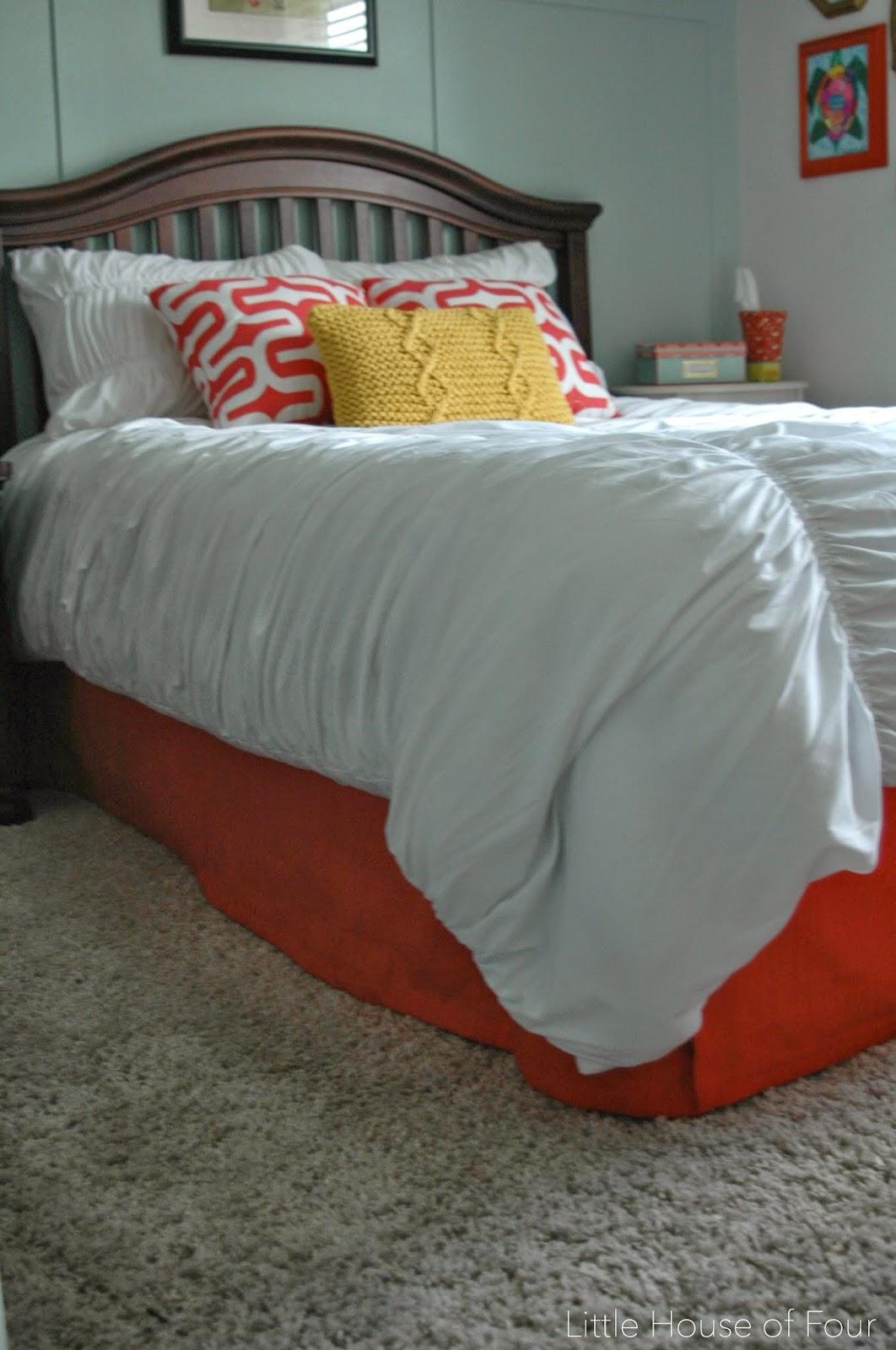 Turn a curtain panel into a bedskirt