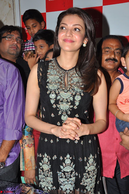 Kajal Aggarwal in lovely Black Sleeveless Anarlaki Dress in Hyderabad at Launch of Bahar Cafe at Madinaguda 003.JPG