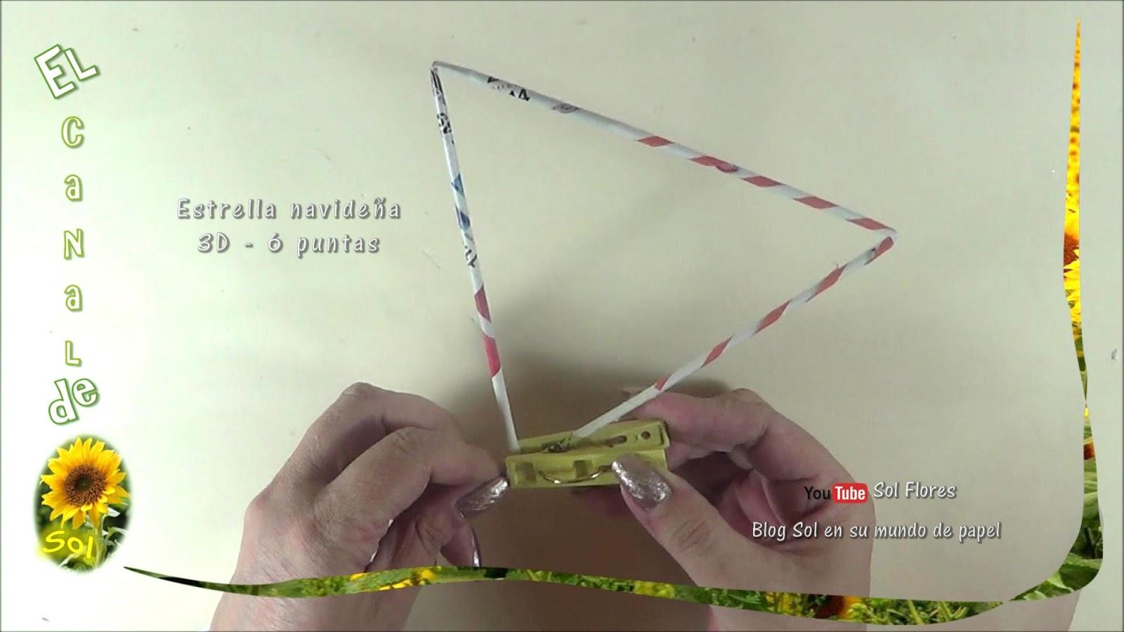Estrella 3D de seis puntas con papel periódico