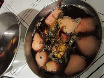 Poached pears, soaking in their cooking liquid