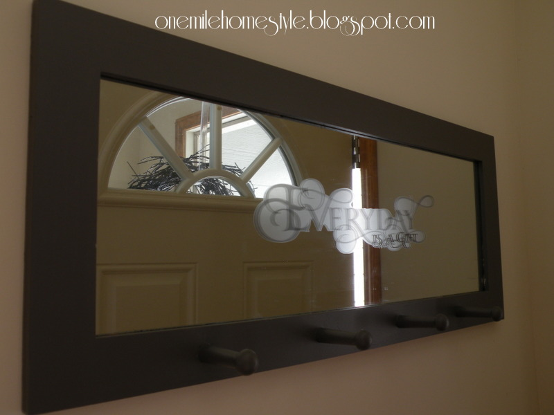 Dark gray framed mirror