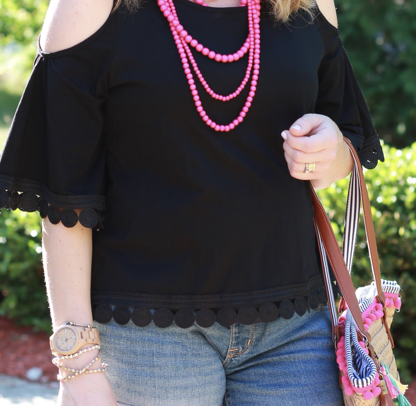 black cold shoulder top, jean shorts, tassel straw tote, steve madden wedge sandals, pink statement necklace, second trimester, summer maternity outfit