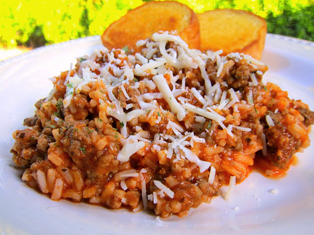 Spaghetti Rice Recipe - homemade meat sauce tossed with rice instead of pasta. Italian sausage or hamburger, tomato sauce, garlic, onions, Italian spices and rice. Ready in about 15 minutes and naturally gluten free! We LOVED this!!