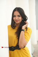Actress Poojitha Stills in Yellow Short Dress at Darshakudu Movie Teaser Launch .COM 0095.JPG