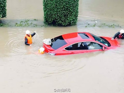 Car Submerged With Passengers Trapped Inside After Heavy Rainfall In China. Photos