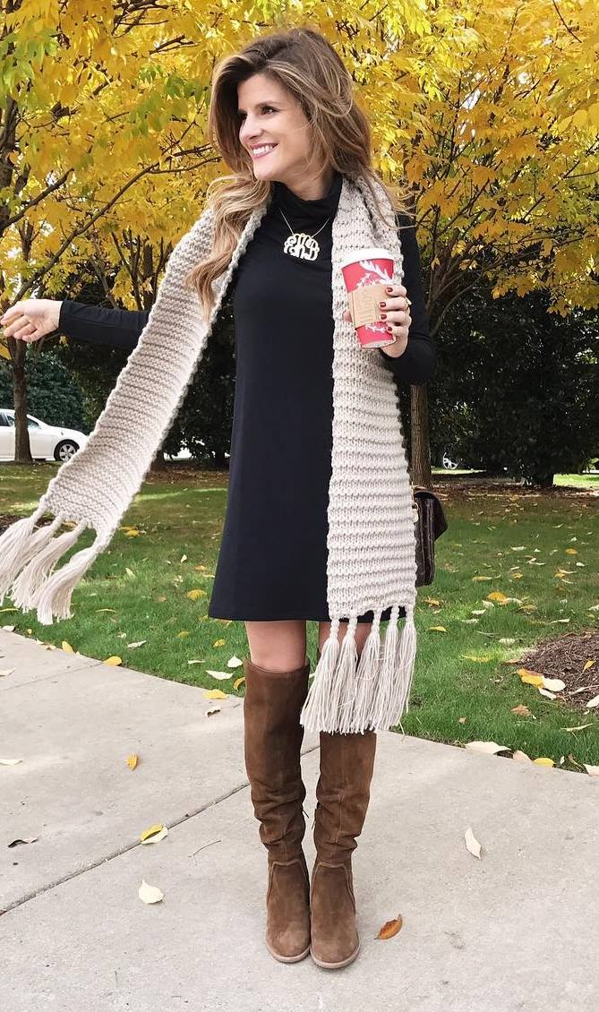 trendy fall outfit : knit scarf + black dress + high brown boots