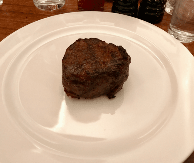 Fillet steak on a white plate