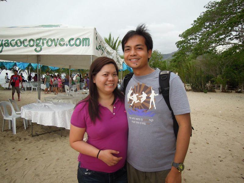 Couple travel bloggers at Laiya Coco Grove Beach Resort