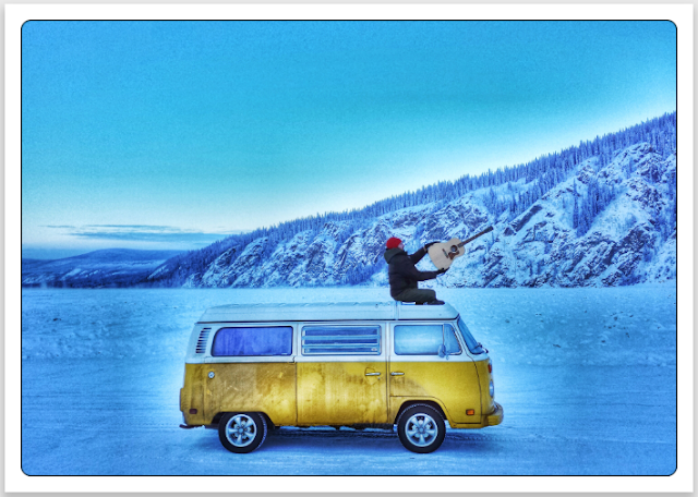 Volkswagen Type 2 Westfalia bus on frozen YUKON river in Dawson city, Canada