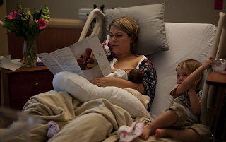 Image: Breast feeding, watching television and ordering room service