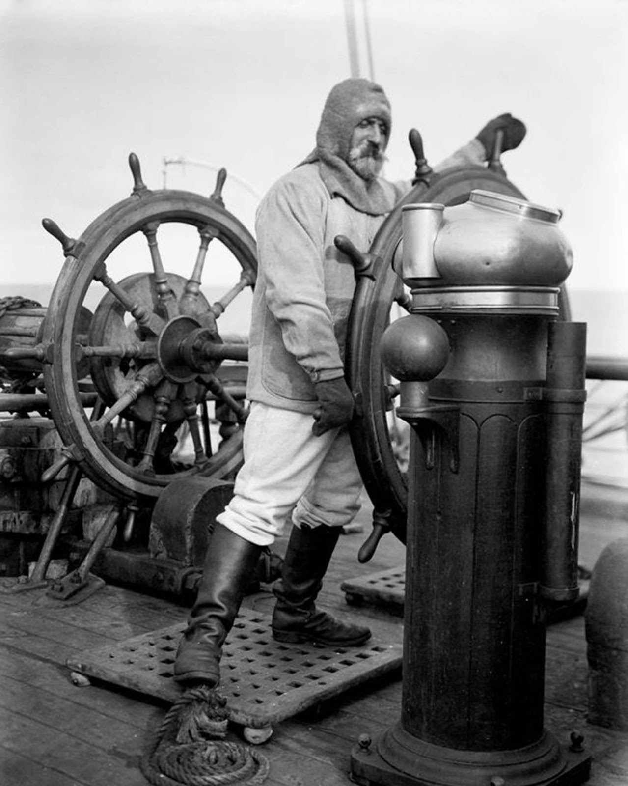 Able seaman Mortimer McCarthy at the wheel of the Terra Nova. 1910.