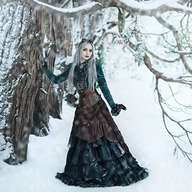 Woman wearing gothic steampunk clothing (aka steamgoth) in emerald green, brown and black. Gothic Victorian Steampunk goths.