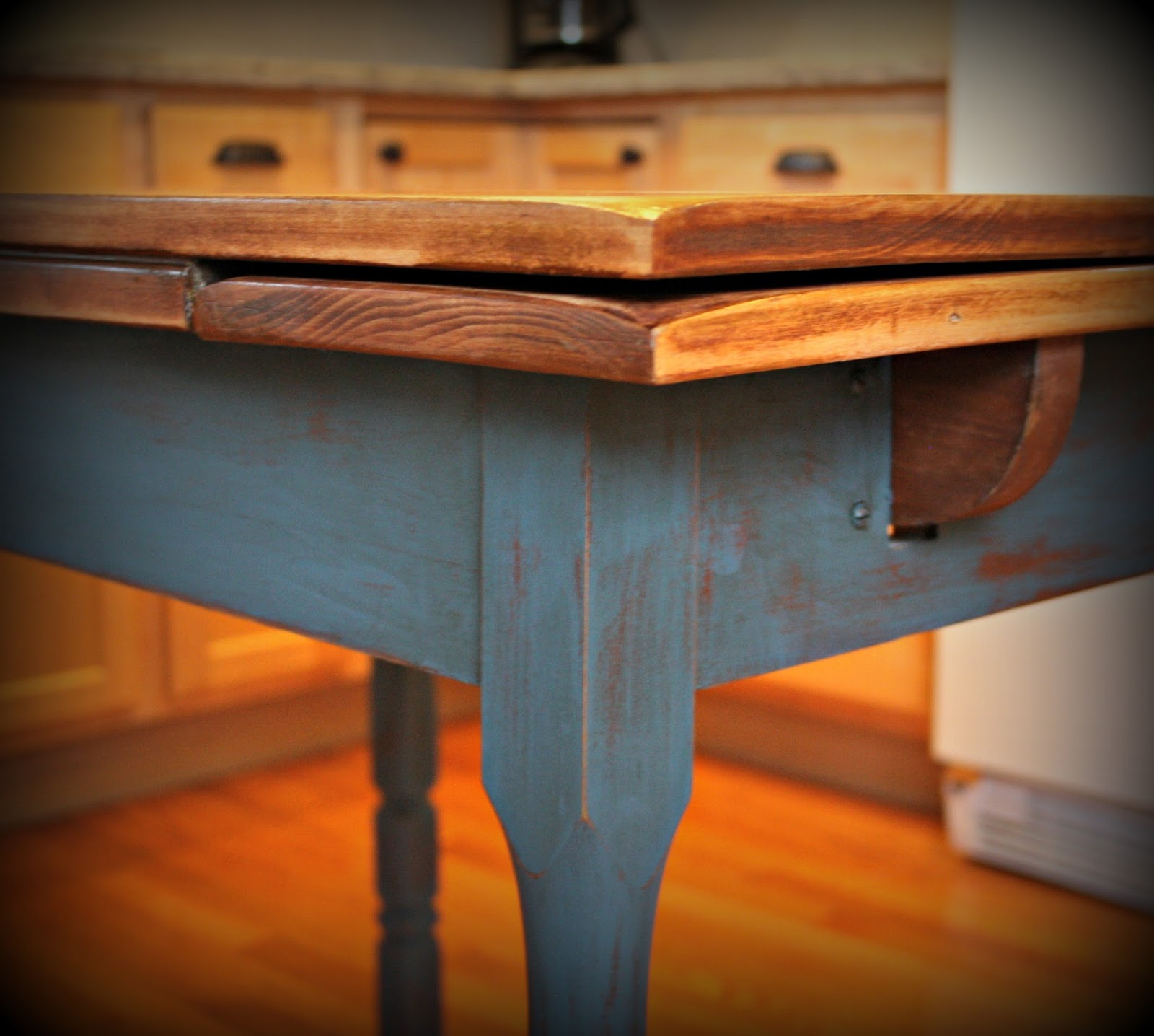 Natural wood top and painted table base.