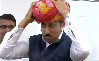 A team of visiting panchayat heads brought a gift for union minister Rajyavardhan Singh Rathore  - clothe to tie a Rajasthani pagari.  A delightful video from ANI shows the junior central minister for information folding it deftly with his hands and building layers of it atop his head.  A former Army officer, and a  silver medallist in 2004 Olympics, Rajyavardhan Singh Rathore is from Jaisalmer and he knew how to rise to the occasion, when the present was handed over.