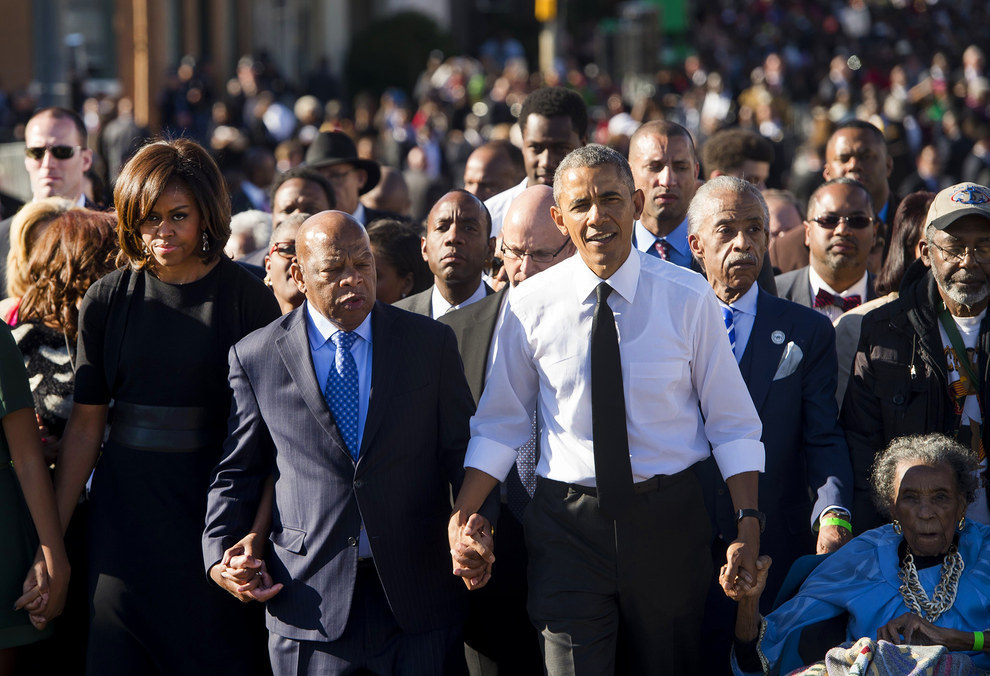 70 Of The Most Touching Photos Taken In 2015 - Walking alongside many of the original marchers, President Obama makes his way across the Edmund Pettus Bridge to mark the 50th Anniversary of the Selma-to-Montgomery civil rights marches in Alabama.