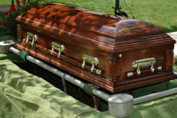 Resultado de imagem para casket being lowered into grave
