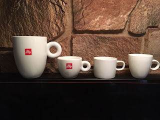 4 coffee cups of varying sizes displayed side by side for a comparison