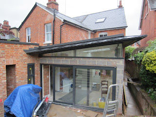 Building site for kitchen extension: glass doors