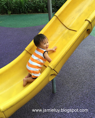 Baby in Carters at the Slide