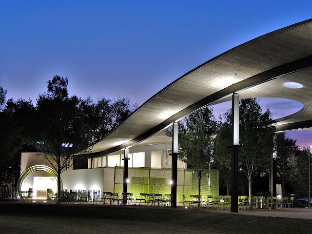 Curved canopy at Levy Park at Night