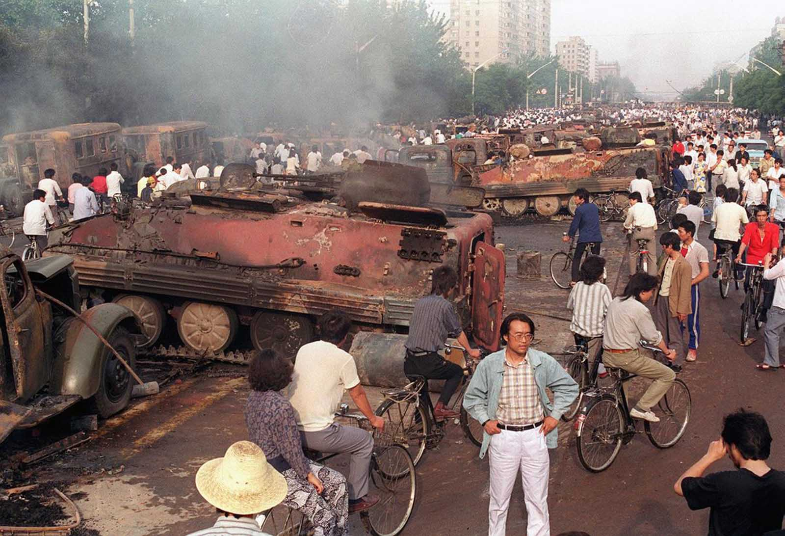 Beijing residents inspect the interior of more than 20 armored personnel carriers burned by demonstrators to prevent the troops from moving into Tiananmen Square, on June 4, 1989.
