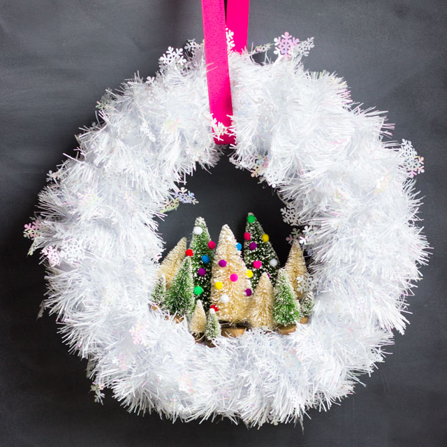 Make this gorgeous Christmas wreath in under 30 minutes with mini bottle brush trees!