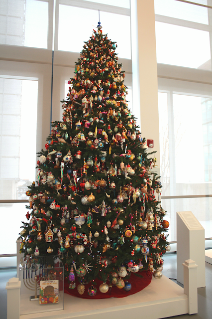 Christmas tree at the Racine Art Museum display hand blown glass ornaments collected over decades.