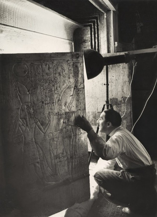 historic photography Howard Carter Looking through the open doors of Tutankhamun's Shrine January, 1924