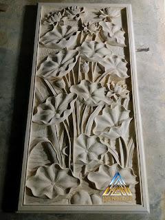Ukiran batu putih gunungkidul motif bunga lotus