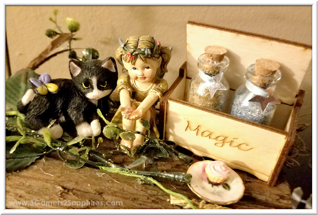 Add a touch of magic to your fairy garden with DIY bottles of fairy dust  |  3 Garnets & 2 Sapphires