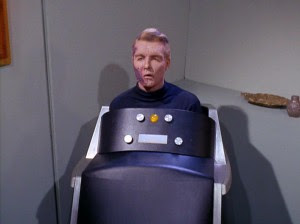 Star Trek's Captain Christopher Pike, in his body-covering wheelchair with electronics