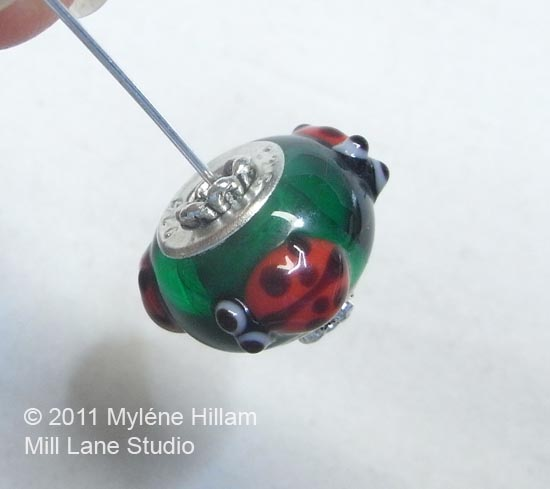 Choose cone shaped bead caps that fit firmly inside the rim of the European style beads to help stablise them.