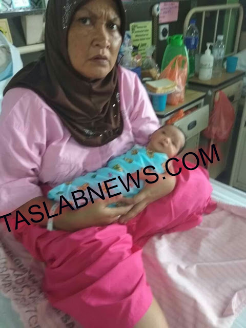 Sri Wahyuni TKI asal Tanjungbalai yang mau jual ginjal di Malaysia bersama putri keempatnya yang baru lahir.