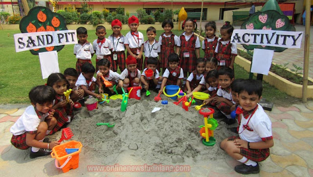 Students taking part in Sand Pit Activity at Spring Dale