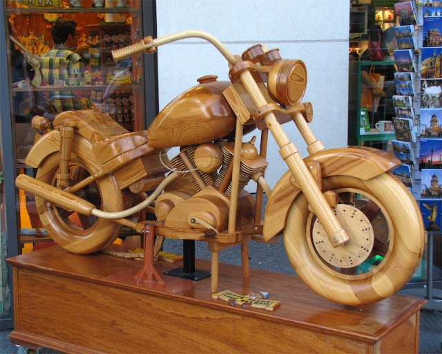 A wooden motorcycle on display, Bartolucci Deutschland, Karl-Liebknecht-Straße, Berlin