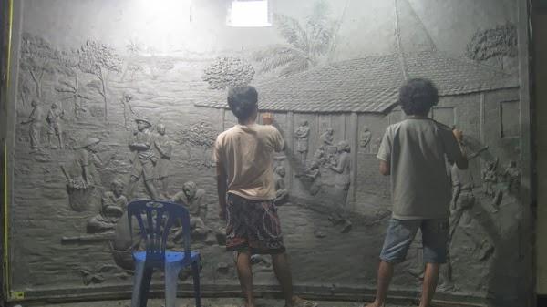 pembuatan relief dinding dari tanah liat