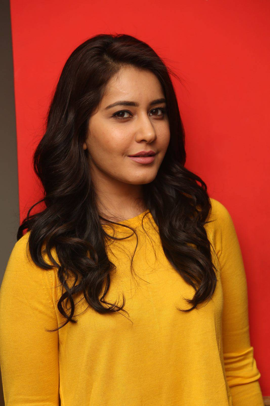 Rashi Khanna Stills In Yellow Dress At Bengal Tiger Movie App Launch