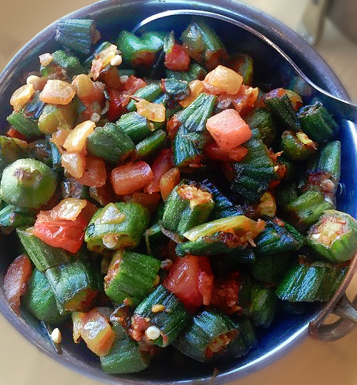 bowl of cooked okra onions tomatoes