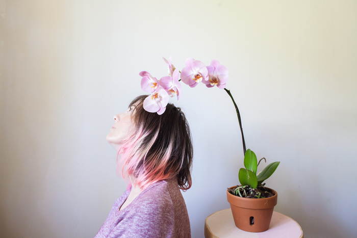 pink haired girl with pink orchid