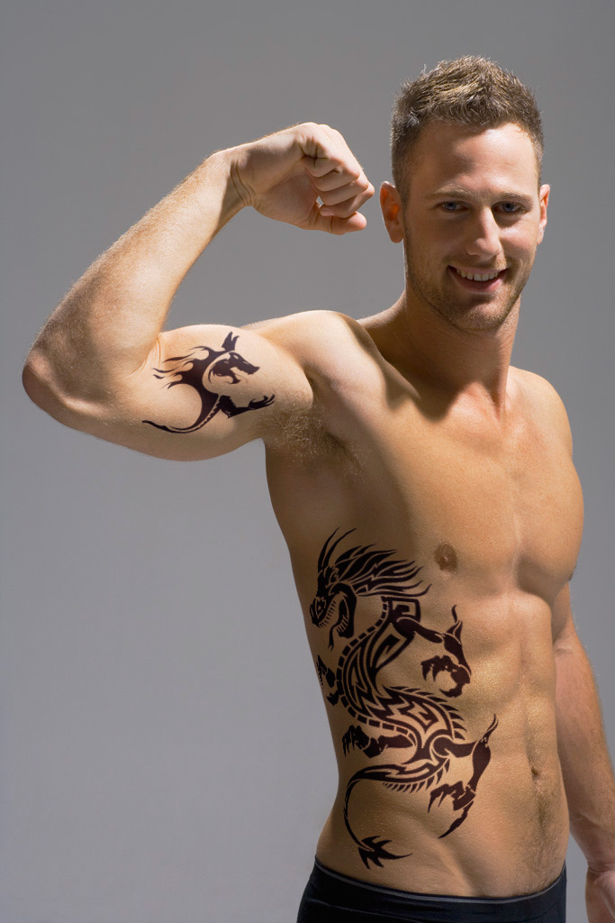 rib and bicep tattoo design for men