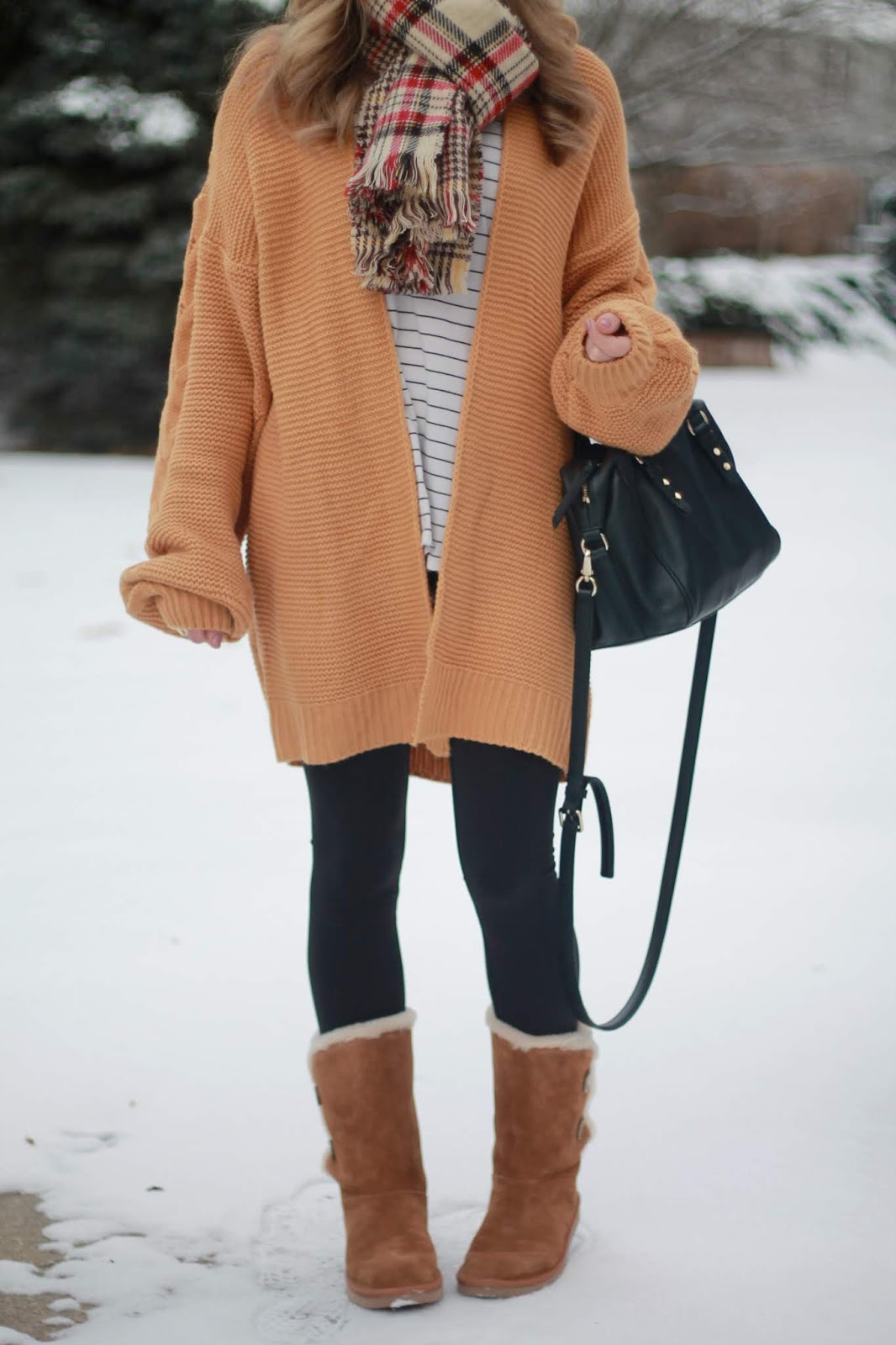 oversized mustard cardigan, striped long sleeve tee, black leggings, kinsley koolaburra, black kate spade crossbody, plaid reversible scarf, white fur pom beanie