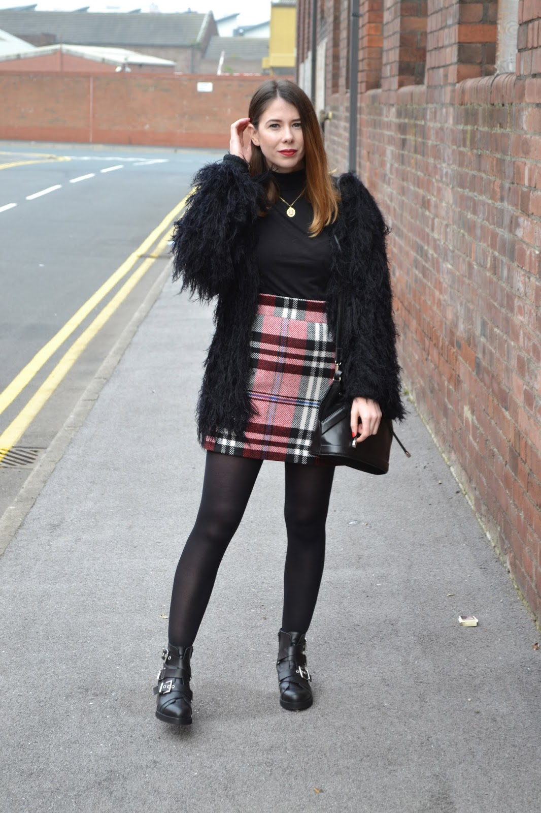 womens affordable highstreet fashion blog featuring British street style. Black polo neck. Topshop tartan skirt. Leather black buckle boots from Kurt Geiger. Black shabby jacket. Hollies closet