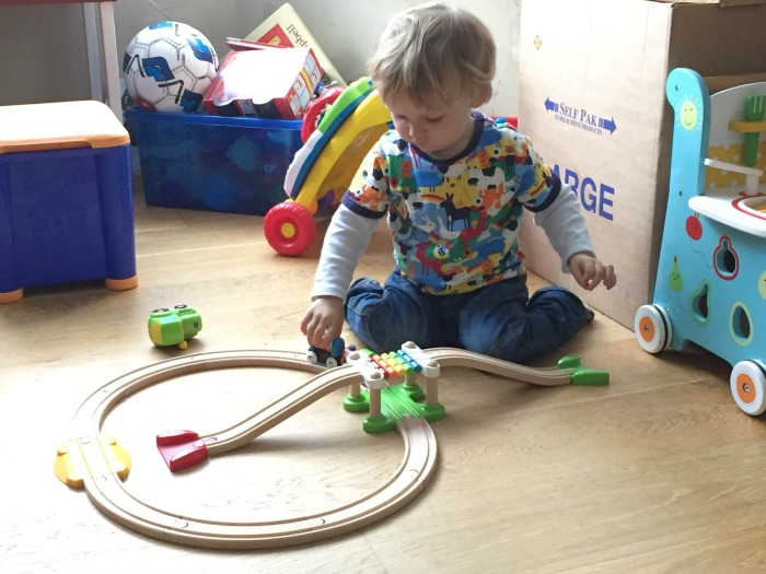 Squidge playing with Brio