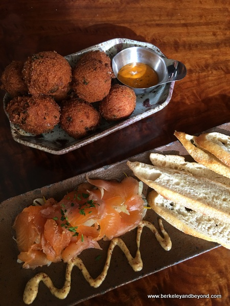hushpuppies and bourbon-cured trout at Hutch Bar & Kitchen in Oakland, California