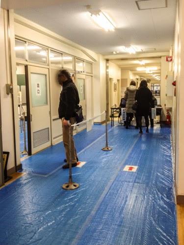 Polling station reception desk, Asakusabashi, Tokyo, Japan.