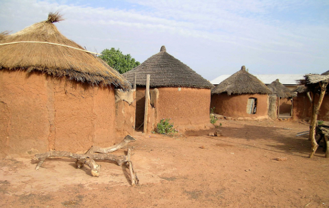 A village with round mud houses with grass roofs