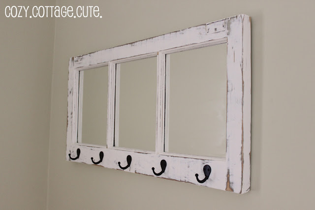 place your favorite scrapbook papers inside each window pane to make a clever piece of art theyve also put 4 different knobs on the bottom frame - Windowpane Frame